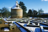 SNOW BLANKETS THE PIGEON HOUSE AND ROSE PARTERRE AT ROUSHAM PARK  OXFORDSHIRE