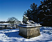 THE DYING GLADIATOR STATUE COVERED IN SNOW AT ROUSHAM PARK OXFORDSHIRE