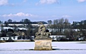 VIEW FROM THE BOWLING GREEN PAST THE STATUE OF A LION AND A HORSE TO THE 3 ARCHED SHAM RUIN. ROUSHAM PARK OXFORDSHIRE